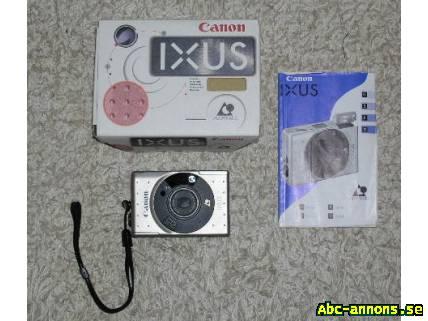 Canon IXUS, IX240 (analog) - Stockholm, Täby - En Canon IXUS IX240 (nr 9138099) (analog) i originalförpackning och med utförlig beskrivning. Inköpt 1996 i augusti. Kontrollerad och justerad av K-R Kameraservice, Täby, i september 2004. Kvitto finns. Ej använd sedan dess. I perf - Stockholm, Täby